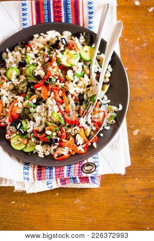 Healthy Warm Salad With Brown Rice, Roasted Bell Pepper, Eggplant, Courgette And Pine Nuts With Mush