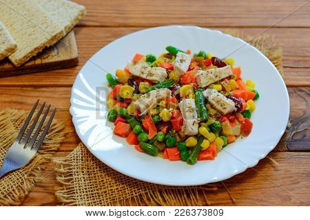 Chicken Breast And Mixed Vegetable Stew On The Serving Plate And The Wooden Table. Low-calorie Chick
