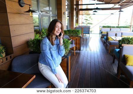Beautiful Female Person Speaking With Boyfriend At Cafe And Discussing Last Dating  . Fashion Girl W