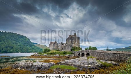 Eilean Donan Castle, Loch Duich, Scotish Highlands, United Kingdom With A Cloudy Dramatic Sky