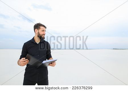 Builder Man Come To Deserted Place To Plan New Residential Complex, Bearded Guy Standing On Sand Hol