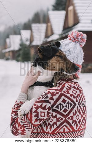 woman and her dog playing outdoor. Girl hugging her dog.