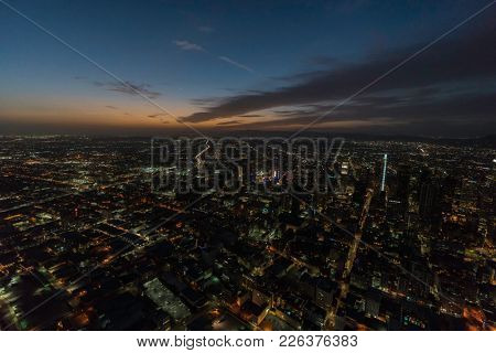 Los Angeles, California, USA - February 11, 2018:  Night aerial view of urban downtown buildings and streets in Southern California.