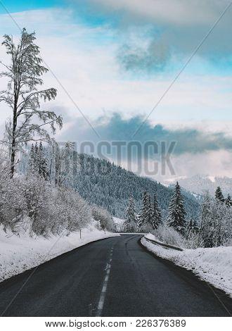 Winter road. Empty road in winter landscape.