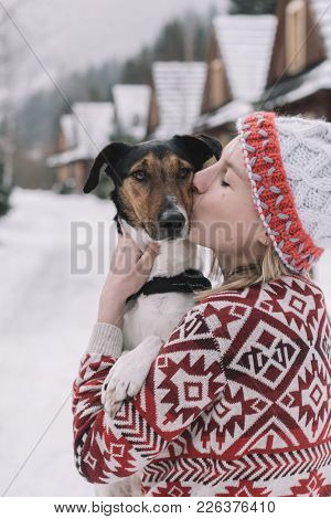 Girl petting a dog outdoors.