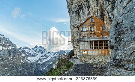 Ebenalp, Switzerland, May 2017: Ebenalp With Its Famous Cliff Inn Aescher. Ebenalp Is An Attractive