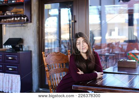 Manicurist Replenish Mobile Account Using Smartphone And Bank Card, Asian Girl Sitting At Wooden Tab