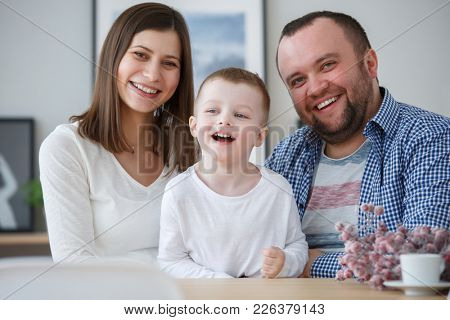 Image of happy family with her son in room