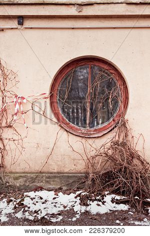 A Round Window On A Building In Tallinn, Estonia. The Capital Of Estonia Is Located By The Sea And M