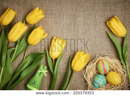 Easter Background, Eggs, Rabbit, Yellow Tulips. Design Hand Painted Decorated Easter Eggs, Happy Bun