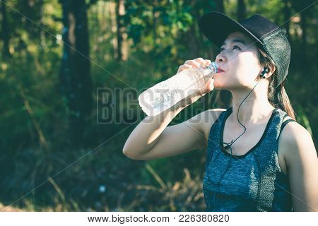 Young Women Stops Drink Water Resting After Running.