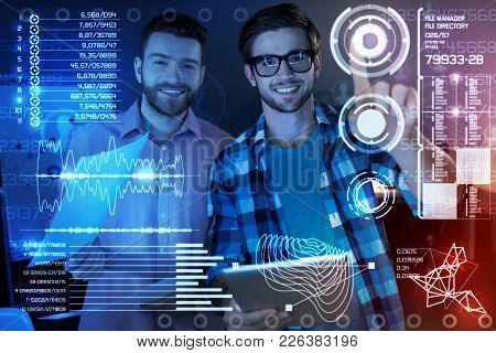 New Program In Use. Cheerful Professional It Men Touching A Transparent Screen While Being Involved