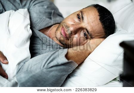 A man lay down on the bed