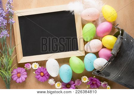 Bucket With Easter Eggs And A Chalkboard - Easter Card With A Rustic Metal Bucket Full Of Colorful P