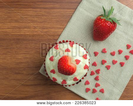 Top-view (high Angle) Image Of Red Velvet Strawberry Cup Cake With Strawberry And Heart Shape Sugar