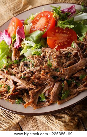 Delicious Food: Slow Cooked Pulled Beef With Fresh Vegetable Salad Close-up. Vertical