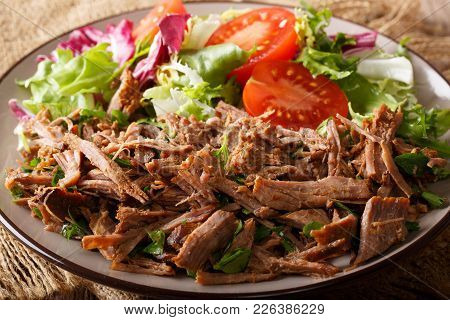 Spicy Pulled Beef With Fresh Vegetable Salad Close-up. Horizontal