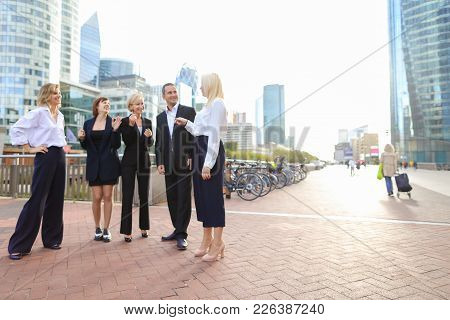 Beautiful Businesswomen Keeping Blue Document Case Talking With Cheerful Male Boss Outside. Concept