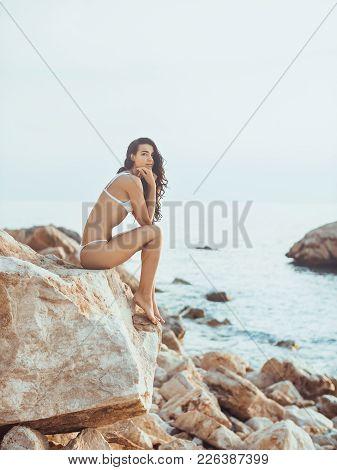 Portrait Of Beautiful Woman On The Sea. Romantic Sensual Brunette Mixed Race Asian Caucasian Woman S