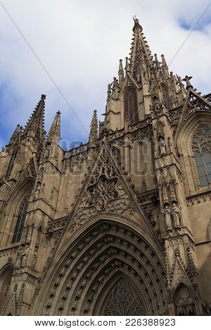 Barcelona, Spain - May 10, 2017: It Is The Spire Of The Main Facade Of The Gothic Cathedral Of The H