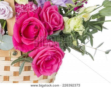 Beautiful Bright Crimson Roses In A Floral Bouquet In A Basket On A White Isolated Background