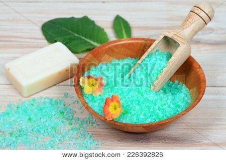 Sea Bath Salt With Spring Herb Extract  In A Wooden  Bowl Decorated With Primrose Flower. Spring Bat