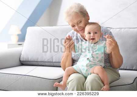 Senior woman playing with her little grandchild at home