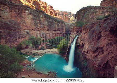 Hawasu waterfall in the Havasupai Reservation in Supai, Arizona in the Southwest corner of the Grand Canyon.