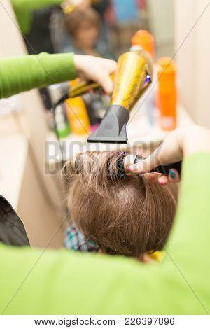 Hairdresser Dries The Hair Dryer Blond  Hair .