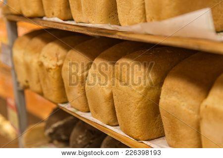 Fresh Bread On The Shelves In The Bakery