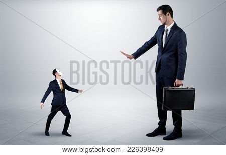 Conflict between small masked businessman and big elegant businessman