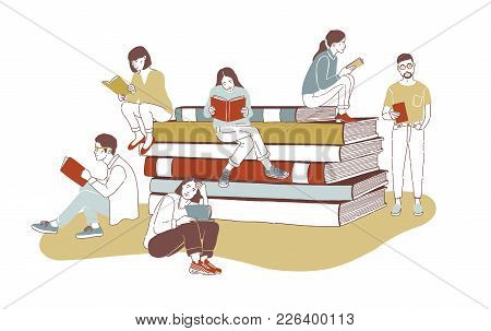 Young Stylish Male And Female Readers Dressed In Trendy Apparel Sitting On Stack Of Giant Books Or B