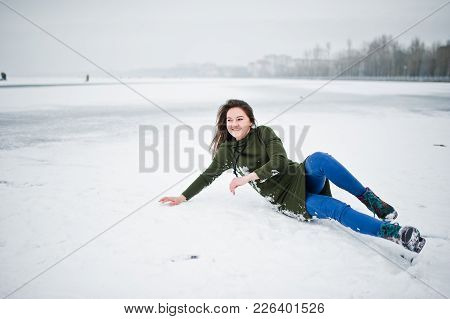 Funny Girl Wear On Long Green Sweatshirt And Jeans, At Frozen Lake In Winter Day.