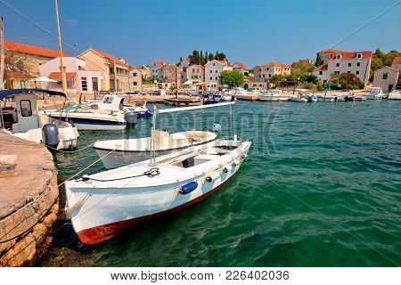 Island Of Prvic Turquoise Harbor And Waterfront View In Sepurine Village, Sibenik Archipelago Of Cro