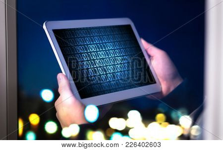 Dark Web And Cyber Security Concept. Man Or Hacker Using Tablet Late At Night. Internet Fraud Or Onl