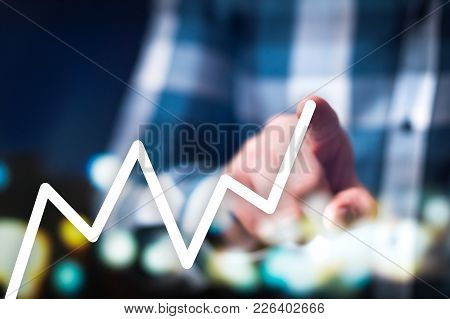 Financial Growth, Success And Progress Concept. Business Man Drawing Growing And Increasing Graph Wi