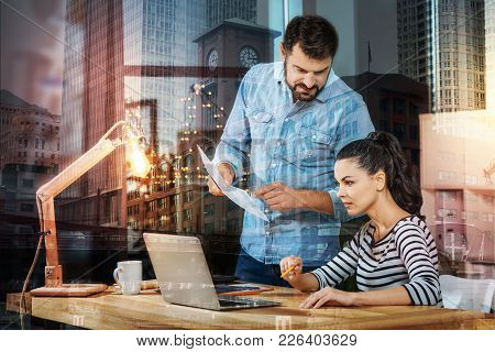 Smart Coworkers. Clever Experienced Cheerful Employee Standing Next To His Beautiful Young Colleague