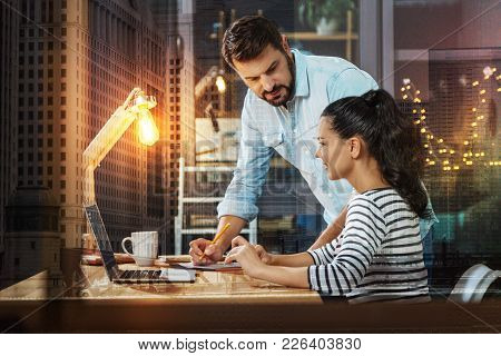 Explanation. Reliable Smart Employer Looking At His Cheerful Emotional New Secretary And Slightly Le