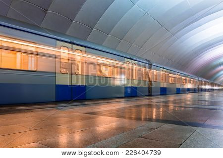 Subway Metro Train Arriving At A Station. Motion Blurr Effect