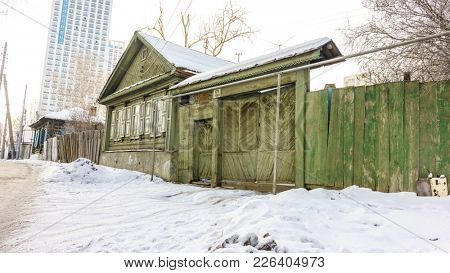 RUSSIA, YEKATERINBURG - FEBRUARY 4, 2018: House is Made of Old Timber, House of Logs, The House is Assembled from Wooden Logs