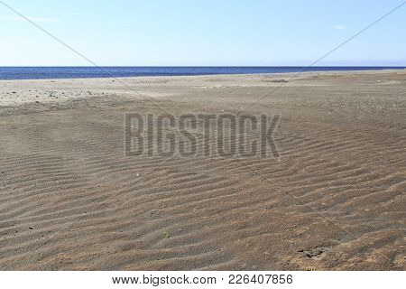 Sandy Coastal Strip With Sharply Outlined Shades From Roughnesses Of Sand