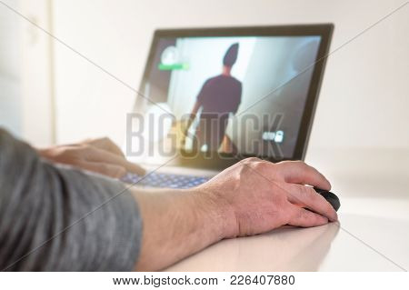 Playing Video Game With Laptop. Gamer With Computer. Young Man Hand On Mouse. Competitive Gaming, El