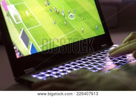 Young Man Playing Video Game With Laptop. Online Soccer Or Football Game In Computer. Close Up Of Ha
