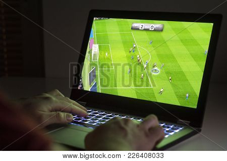 Soccer Or Football Video Game In Laptop. Young Man Playing With Computer. Online Gaming And E Sports