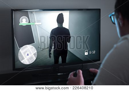 Playing Console Games Or Video Game Addiction Concept. Person Looking At Tv Screen Very Close And Ho