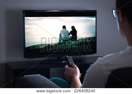 Man Watching Tv Or Streaming Movie Or Series With Smart Tv At Home. Film Or Show On Television Scree