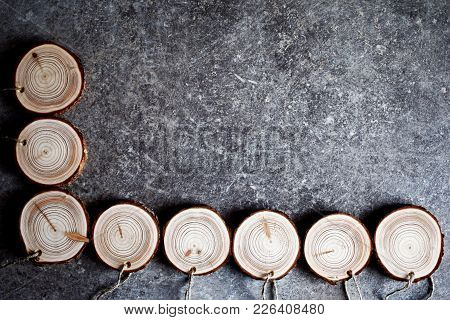 Natural Wood Handmade Medals With Linen Twine. Stack Of Wooden Homemade Medals On Grey Grunge Table.
