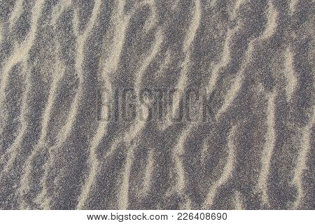 Macroshooting Of A Background From A Mix Of Waves Of Dry River And Volcanic Sand