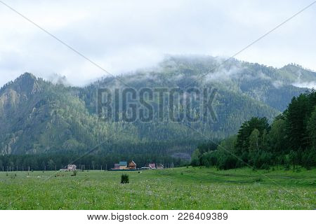 View On The Village, The Ridge And The Curling Fog