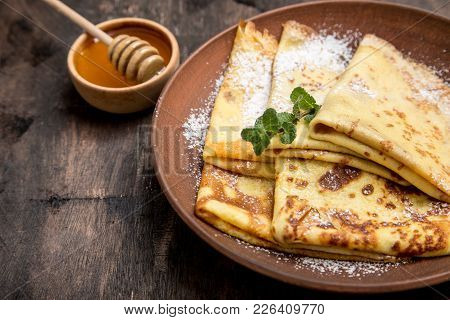 Fresh Pancakes With Fragrant Maple Syrup And Honey. Russian Holiday Pancake Week. Crepes With Honey